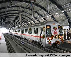 A Delhi metro train waits at the Indraprastha station platform