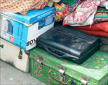 The steel suitcase and the holdall