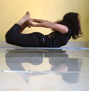 Dhanurasana (Bow, advanced version)