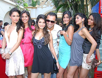 Atul Kasbekar poses with all the Kingfisher models at the calendar launch