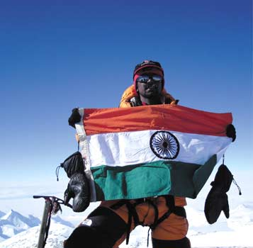 Malli Mastan Babu with the Indian flag on top of Mt Vinson Massif, Antarctica's tallest peak