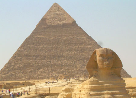The Sphinx with the pyramids as a backdrop.
