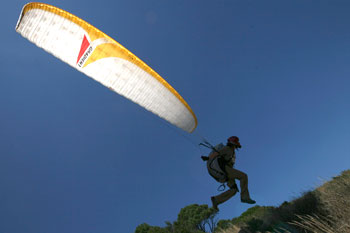 A paraglider gets airbourne in windless warm contitions off Cape Town's landmark Table Mountain.