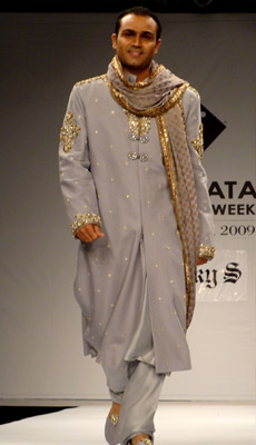 In a rare occasion, Indian cricketer Virender Sehwag walked the ramp for ace designer Rocky S on the first day of Kolkata Fashion Week (KFW) II in September 2009