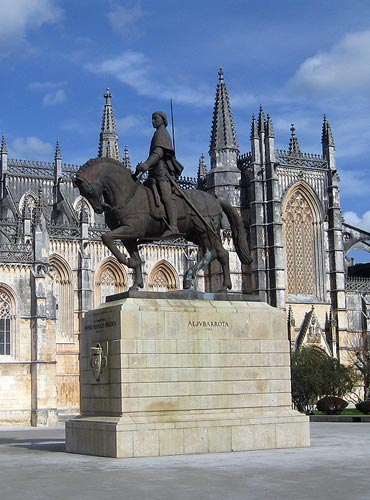 Statue of Nuno Pareira against the backdrop of Batalha Abbey