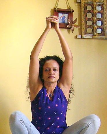 Kashtha Takshanasana (wood chopping pose)