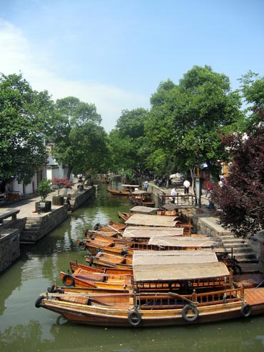Tongli Water Town near Suzhou, is a well-preserved tourist spot with water lanes.