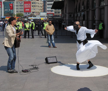 A whirling dervish wearing a gas mask, at an environmental protest in Istanbul.