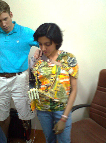 Shreya tries out a prosthetic arm