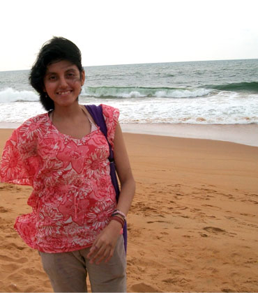 Shreya enjoys a walk on the beach in Kerala