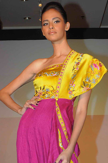A model walks in one of James Ferreira's creations