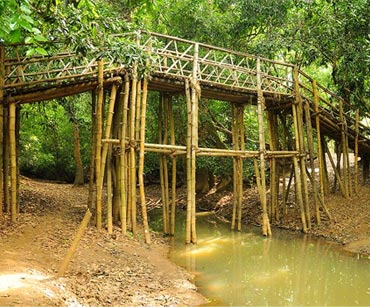 One of the temporary bridges in Kuruva Island, 950-acre protected river delta on the Kabini River in the Wayanad district, India.