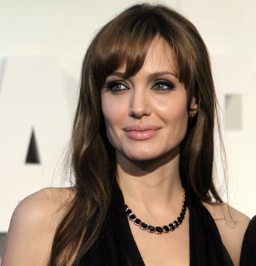 Angelina Jolie wearing the black and rose gold necklace which will be part of her collection