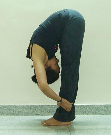 Uttanasana (Forward bend, Advanced variation)