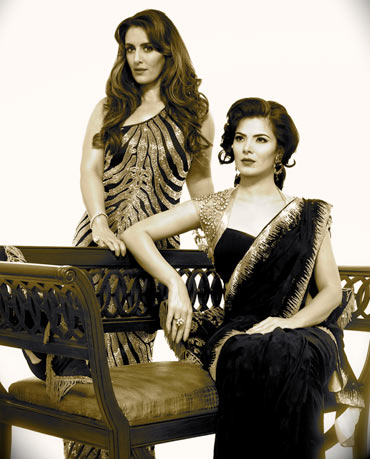 Designer Pria Kataaria Puri (standing) poses with model Urvashi Sharma