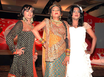 Members of the transgender community sashay down the ramp at a press conference held in Mumbai yesterday