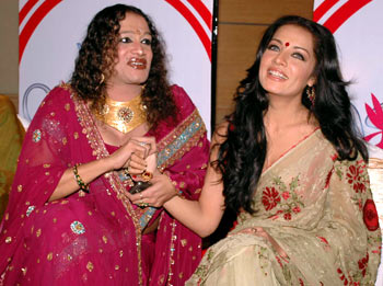 Laxmi Narayan Tripathi and actress Celina Jaitley share a light moment