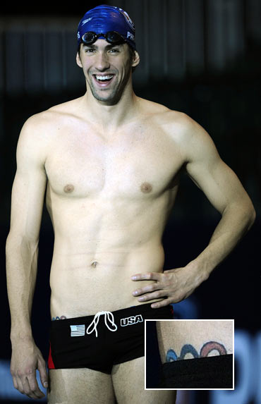 You can just see the Olympic rings peeking from swimming champ Michael Phelps' trunks