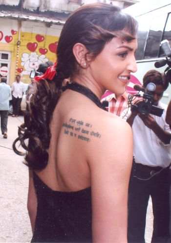 Esha has a mantra etched on her back