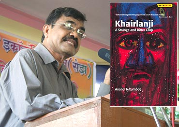 Dr Anand Teltumbde at a public hearing in Pen against SEZs. Inset: Cover of his book Khairlanji: A Strange and Bitter Crop