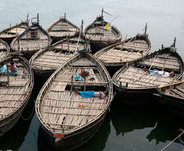 Boat men rest on their boats at Dhulian village in Murshidabad district of West Bengal.