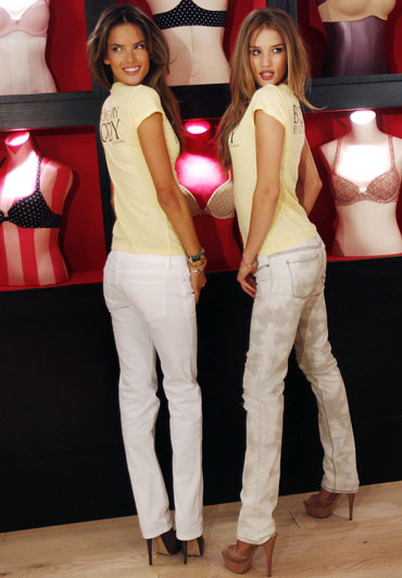 Victoria's Secret supermodels Alessandra Ambrosio (L) and Rosie Huntington-Whiteley pose for photographers during the Celebrate the Body by Victoria Collection news conference in New York