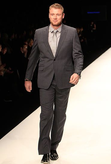Former England cricket all-rounder Andrew Flintoff took our breath away as he walked down the ramp in dapper charcoal-grey suit at Naomi Campbell's Fashion For Relief Haiti London 2010 Fashion Show at Somerset House in London on February 18, 2010