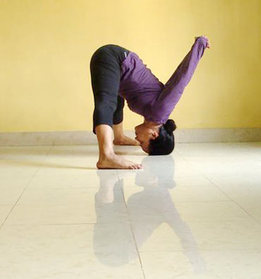 Moordhasana (Crown-based pose)
