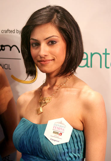 Contestant Gurpreet Bedi faces the cameras in a funky gold neckpiece