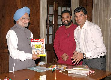 From left: Dr Manmohan Singh with the first copy of the Hindi edition of Careers360 by Editor Mahesh Sarma and Maheshwer Peri