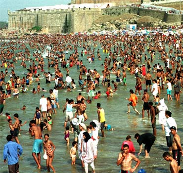 Thousands of Moroccans crowd the Atlantic coast beach in Rabat