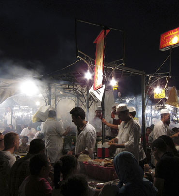 People eat at food stands in Djemaa El Fna square in Marrakesh.