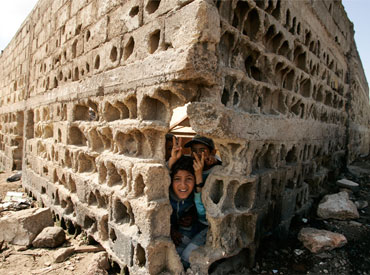 Children play by a wall at Tomas slum in Casablanca