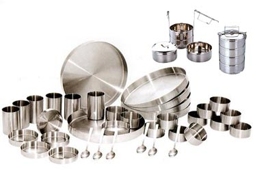 A stainless steel dinner set and tiffin carrier