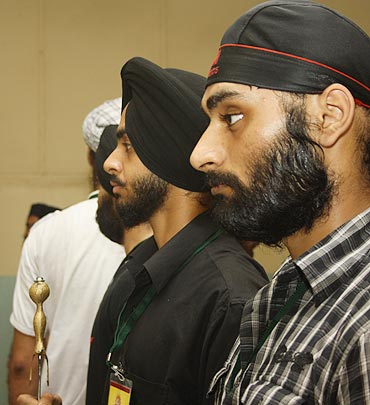 The aspirants line up during a rehearsal at the gurdwara complex