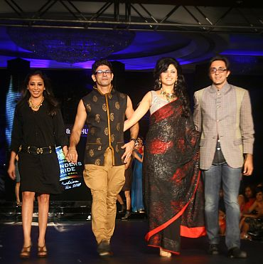 Sonal leads Rahul and Gunjan out onto the ramp