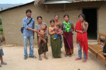 Rustam Sengupta standing with some Boond product recipients in Manipur