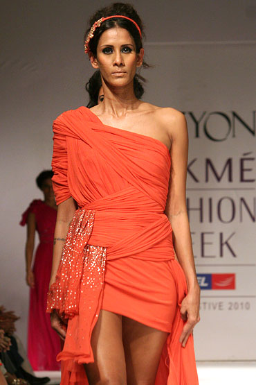A model showcases a creation from the Vizyon label