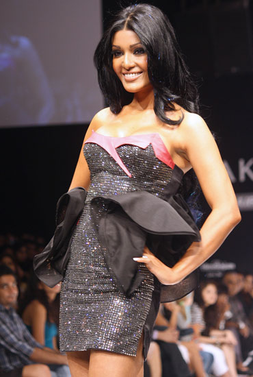 Koena Mitra showstops for Rajat Tangri
