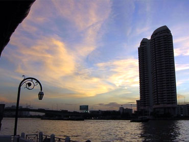 Bangkok from the Chao Phraya River at sunset.