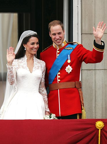 Their Royal Highnesses Prince William, Duke of Cambridge and Catherine, Duchess of Cambridge greet well-wishers from the balcony at Buckingham Palace on April 29, 2011 in London, England.