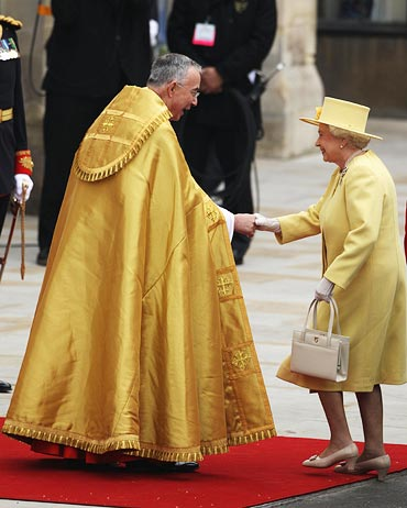 Queen Elizabeth II greets The Right Reverend Dr John Hall, Dean of Westminster