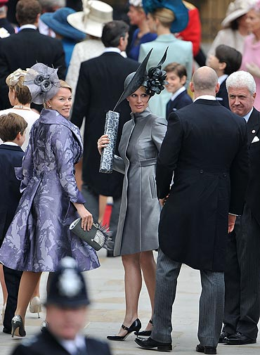 Zara Phillips (centre) and Mike Tindall (with his back to the cameras)