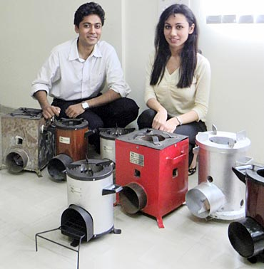 Mathur and Juneja with the various designs that the stove went through