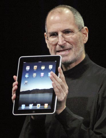 Apple chief executive officer Steve Jobs with the new iPad