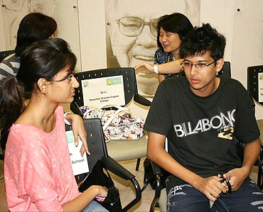 Harshvardhan interacting with a fellow student at the competition