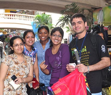 Aayush Thakral poses with his first set of customers