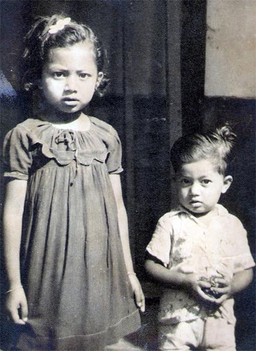 Dr Prafulla C Deka (right) with his sister back in 1955