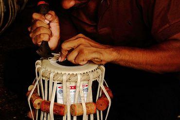 Tabla maker working on Ustad Zakir Hussain's tabla. Mahim Causeway