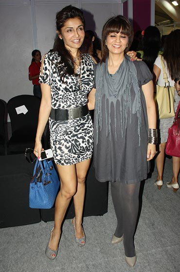 Queenie Singh and designer Neeta Lulla pose for the flashbulbs